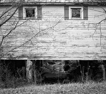 Black and white photo of a rural wooden shack
