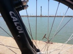 panorama of the river through a bicycle wheel