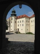 view of the castle through the arch in poland