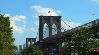 flag on top of brooklyn bridge