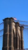 america flag on brooklyn bridge