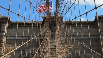 america flag on brooklyn bridge metal grid