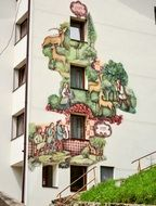 artistic drawing on the facade of a house