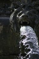 monument in the form of a lion with a fountain