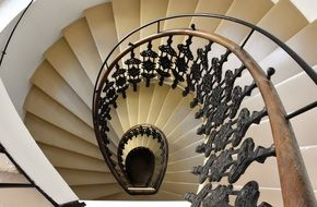 spiral staircase with wrought iron railing