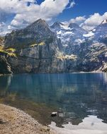 blue lake in the alps in switzerland