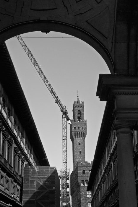 black and white photo of a construction crane near the building