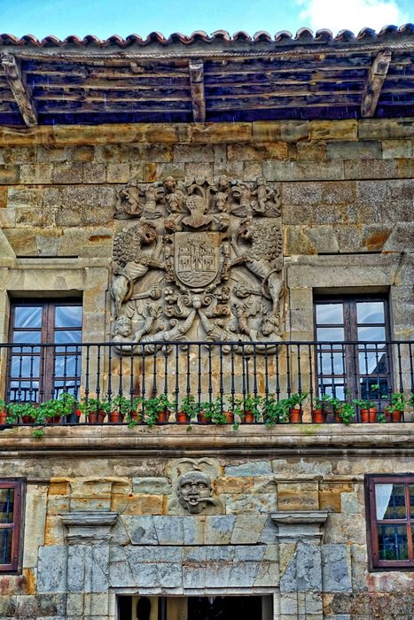 balcony with flowers of an old stone building