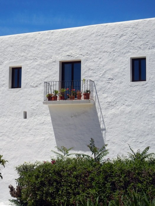 white building with balcony in Ibiza
