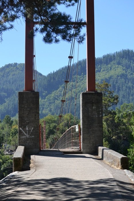 gateway of suspension bridge at green mountains