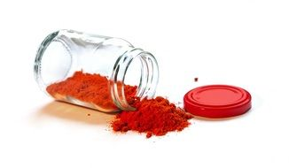 glass container with red powder