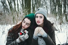 young models in winter forest