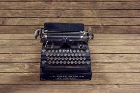 vintage typewriter on the wooden table