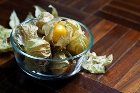 delicious physalis fruits in the glass bowl