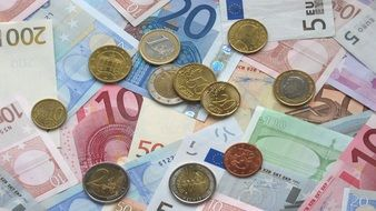 Euro notes and coins on the table