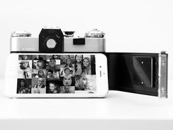 Iphone and digital camera in black and white