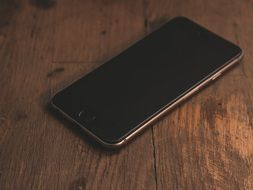 Black Iphone On The Wooden Table Free Image