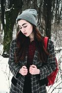 beautiful young model posing in the winter forest