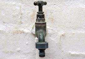 water faucet in the wall