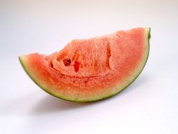 a slice of watermelon on a white surface