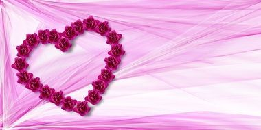 heart of flowers on a pink background
