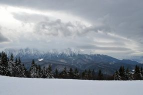 winter landscape on the mountain under the clouds
