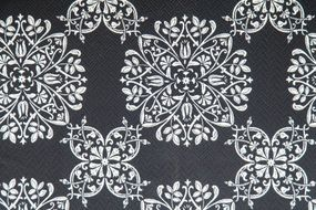 grey wallpaper with white floral pattern