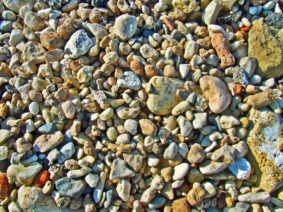 background with natural pebbles on the shore