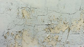 wall with peeled paint layer