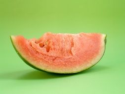 pink slice of watermelon on a green background