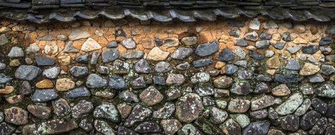 roof tile over stone wall