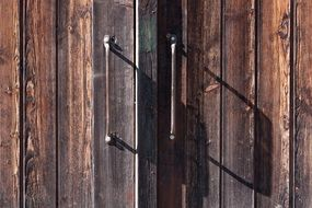 old wooden gate with iron handles