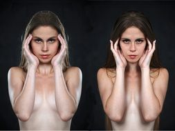two nude girls with hands in the face