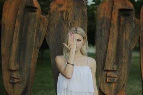 blonde girl covers her face