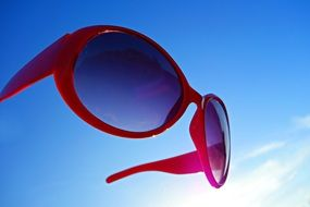 sunglasses against blue sky