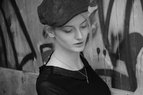 young woman posing in the hat