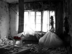 girl in a wedding dress in a ruined house