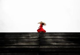 girl in a red dress on the horizon