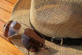 sunglasses and straw hat