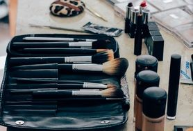brushes and makeup products on the table