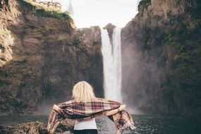 portrait of blonde hair women near the waterfalls