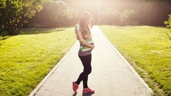 Photo of pregnant girl in a park