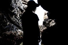 silhouette of human in a cave
