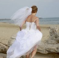 bride in white dress on the beach