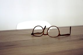 glasses lie on a table in the sunlight