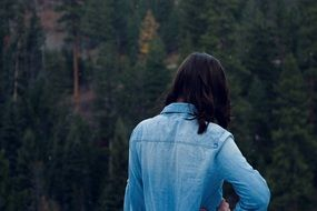 backview of girl in a blue jacket