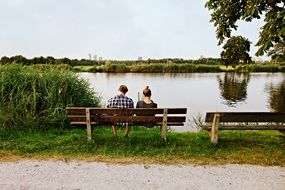 People on a bench by the lake