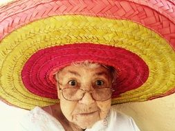 Old Woman in colorful Sombrero