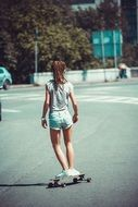 young woman on skateboard