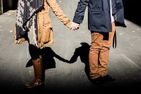 couple with holding hands